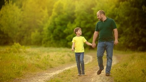 father walking with autistic son