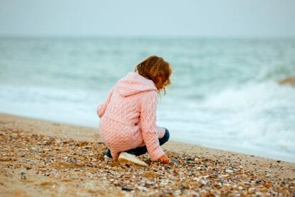 autistic girl on beach