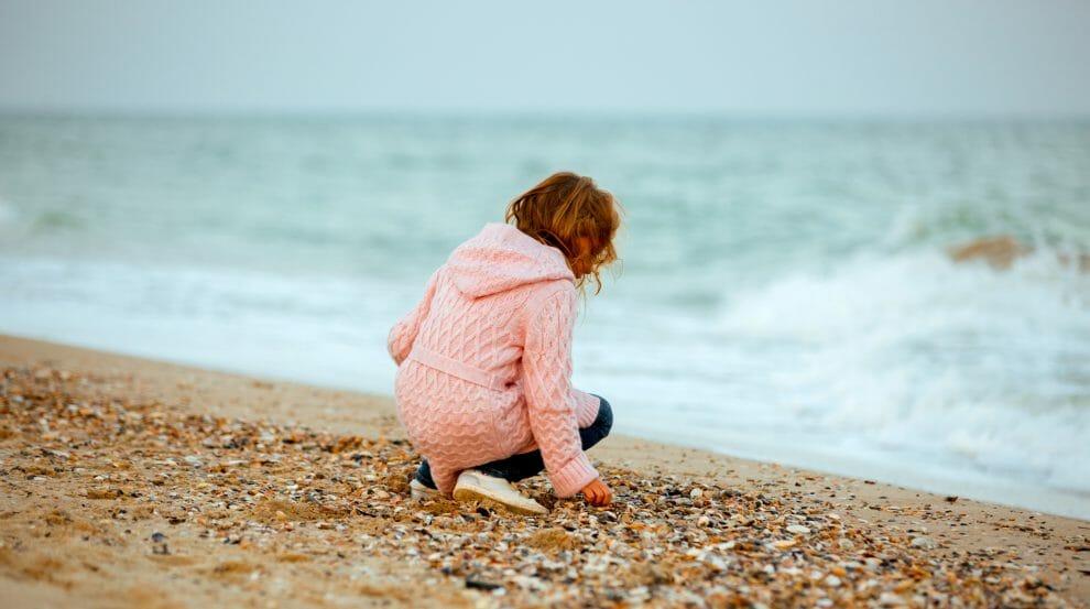 autistic girl on beach