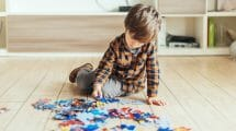 nonverbal autistic boy plays with puzzle
